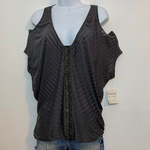 Gray cold shoulder top by Guess is NWT. Medium